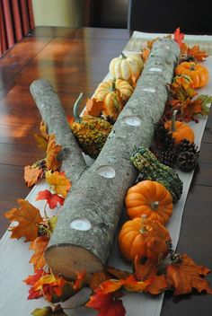 DIY autumn log centerpiece I have a smaller one my husband it for me exactly like this to put tealights in for my bay window ..it's a great idea!(my husband carved our family's names in it and the year we went camping...it was a Random aspen log the kids found on our trip)