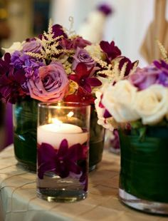 Use different hues of purple to create depth in your tablescape, as seen with these purple roses and orchids.