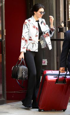 Kendall Jenner in an orchid-print jacket by Ganni.