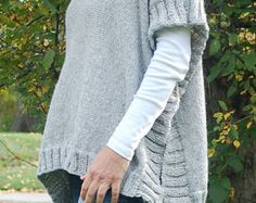 """Remy is an easy to knit poncho pattern. A great transition piece you can wear when a coat is too much and a sweatshirt just doesnt measure up! Look pulled together in seconds. And, its very simple to knit! Skills Needed   Casting On  Stockinette Stitch- alternate knitting one row, purling one row  Ribbing- Knit 2 stitches, purl 2 stitches  Picking up stitches for the rib  Binding off  Videos are provided for basic techniques as well as """"how to"""" steps specific to this pattern.  Yarn  We used…"""