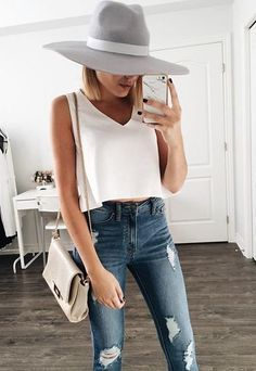 Simple outfit. White top and broken denim jeans.
