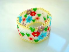 Flower-Power Peyote Ring Size 13. $14.00, via Etsy.