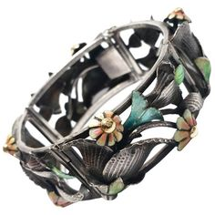 Catalan Art Deco Flower Bracelet. Beautiful Catalan Art Deco bracelet in silver with flowers in green, blue and pink enamel, c 1930, Spain