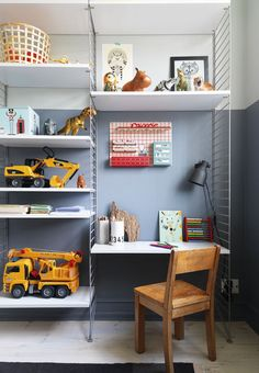 Bookshelf rack system with a small desk space - great idea for storage and extra space.
