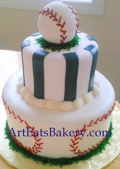 Boy's baseball baby shower cake cake with blue stripes, baseball topper and grass