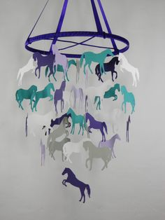 Heres a fun mobile featuring Horse silhouettes in different poses! This decorative piece is perfect above your babys crib or can be the main piece in your childs bedroom. THIS MOBILE IS MADE TO ORDER AND WILL TAKE SOME TIME TO CREATE. MY PRODUCTION TIME IS 20 days. This mobile hangs on a 12 inch hoop that is wrapped in coordinating ribbon.This mobile is created with high quality, textured card stock. The horses can be seen in any direction as they are carefully glued on both sides. This…