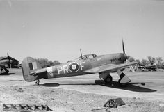 "Typhoon Mark IB, DN604 'PR-F' ""Mavis"", of No. 609 Squadron RAF, on the ground at Manston, Kent. The aircraft displays a score tally of 18 locomotives destroyed in ground attacks on the fuselage side"