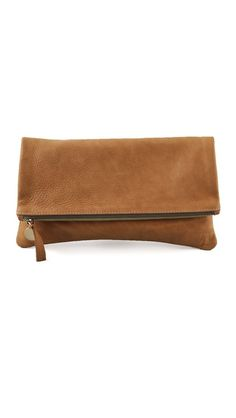 """CLARE VIVIER Fold Over Clutch  This folded, pebbled leather clutch features a logo pull at the zip closure.    * 5.5""""H x 11.5""""L (folded).  * 11""""H x 11.5""""L (unfolded).  * Leather: Lambskin.  * Weight: 6 oz / 0.17 kg  * Made in the USA."""