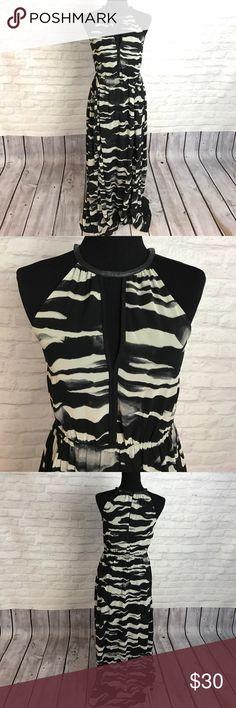H&M maxi dress Maxi, halter dress with keyhole front/back detailing. Faux leather neckline detail. Button back closure. Stretch waist. Never worn. H&M Dresses Maxi