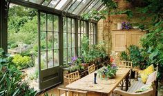 Love the indoor-outdoor living feel of this beautiful glass-panelled sunroom!