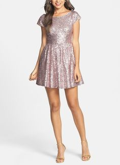 Pretty pink party dress! Love the glittery sequins on this skater dress.