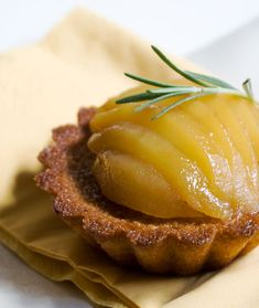 Almond financier with rosemary scented poached pears