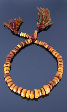 Morocco - Anti Atlas, Tiznit, Ait Atta | Necklace; amber separated with felt washers on braided wool | 4'340€ ~ sold (May '15)