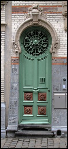 Green door Ghent by Blackburn lad1, via Flickr    Lovely combination of materials, color, and texture going on here!
