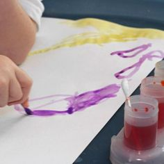 Paint with Q-Tips - Afraid of toddler messes? Use Q-Tips for this mess-free water color fun.