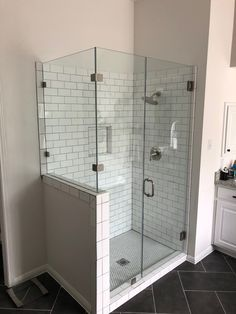 Custom Glass Shower Enclosure - 90 Degree Glass Shower Enclosure with Notched Inline Panel at Half Wall. Contact Arrow Glass and Mirror, located in Austin, TX today to learn more 512-339-4888 or email sales@glassgang.com.