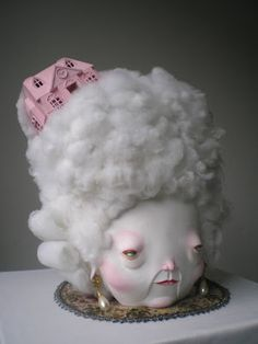 "pink - woman with house - ""in the clouds"" - sculpture -   Lydia Dekker - Horriblesweet"