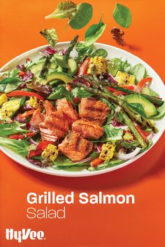 Healthy dinner is served! Add some freshly grilled salmon to a homemade salad filled with greens.