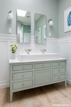 Keeping with a traditional style, designer Susan Templer added a contemporary twist with a clean, fresh colour palette of Resene Half Robin Egg Blue and Resene Quarter Black White panelling to this bathroom. The custom designed vanity, in the same soft green of the walls, is a perfect complement to the bright white panelling and fixtures.