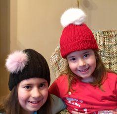 Αριστερά/Left: Μαύρο χειροποίητο πλεχτό μάλλινο σκουφάκι με  πραγματικό γούνινο ροζ πομ πομ / Black handmade knitted woolen hat with real fur pink pom pom  Δεξιά/Right: Κόκκινο χειροποίητο πλεχτό μάλλινο σκουφάκι με  πραγματικό γούνινο άσπρο πομ πομ / Red handmade knitted woolen hat with real fur white pom pom