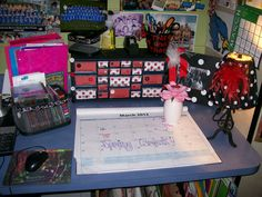 What an organized teacher's desk and it is also decorated! I love the toolbox on the teacher's desk!