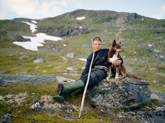 Sami Herder, Scandinavia    Photograph by Erika Larsen.  Johan Kuhmunen, with his dog Cammu, lives in Sweden, but the summertime range for his family's herd crosses into Norway. The Sami tradition of learning from the elders is an important part of reindeer herding, and knowledge is passed down from generation to generation and not learned in books.
