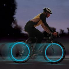 LED Neon Color Lights that fit your bicycle wheel and create a circle of Neon LED lights when in motion.  Good for safety and fun to have.   The lights easily attach to the stem of the bike wheel and can be changed easily.   Runs on  3 button cells included with each light.