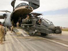 Soldiers from Combat Aviation Brigade, out of Ansbach, Germany offload an Apache helicopter from a Galaxy cargo aircraft in Mazar e Sharif, Afghanistan on 28 April, Attack Helicopter, Military Helicopter, Military Guns, Military Aircraft, Military Vehicles, Military History, Ah 64 Apache, Cargo Aircraft, Military Equipment