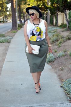 Gabi Fresh has an ultra-fashionable Military Moment in this plus-size olive green pencil skirt and graphic tank from Addition Elle.