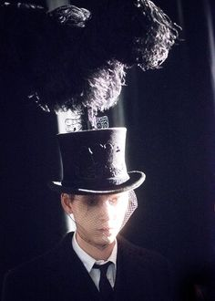 Top hat with showgirl ostrich plume backstage at Thom Browne AW15PFW. See more here: http://www.dazeddigital.com/fashion/article/23400/1/thom-browne-aw15