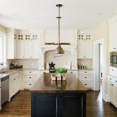 backsplash: 3 x 6 oatmeal travertine (Daltile). granite: giallo ornamental. cabinet: similar to bm cloud white. wall: BM Monroe Bisque. butcher block: custom