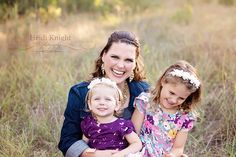Mom and daughters laughing.    Heidi Knight Photography