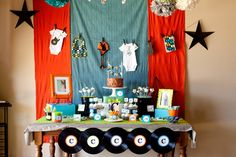 I love the clothes line idea and the fabric hanging off the back wall, we could do something like that in our bay window area