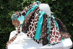 in pinks - Giraffe and Turquoise Fabric Tutu With Matching Headband. $25.00, via Etsy.
