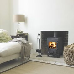 The Morsø 1430 Squirrel wood burning stove is a small but perfectly formed multi-fuel stove. It comes with a stay-clean glass, convenient ashpan. It is easy to see why the Morsø 1400 Squirrel Series is the most popular small cast iron stove in Britain. My Living Room, Home And Living, Living Spaces, Morso Stoves, Wood Stoves, Small Wood Burning Stove, Multi Fuel Stove, Stove Fireplace, Inglenook Fireplace