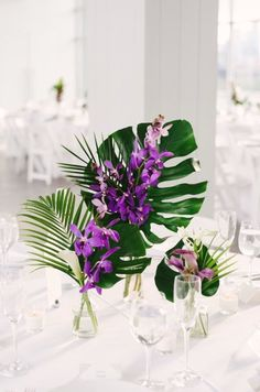 Purple Wedding Flowers Tropical wedding centerpiece idea - palm leaves and purple flowers {Whimsy Weddings - Planning, Florals, Tropical Wedding Centerpieces, Tropical Flower Arrangements, Wedding Flower Arrangements, Wedding Decorations, Tropical Wedding Decor, Tropical Weddings, Non Floral Centerpieces, Wedding Ideas, Budget Wedding