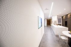 The Wave House's interior walls feature intricate patterns