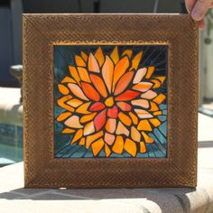 Orange. Yellow. Vibrant. Dahlia. Bold. Dramatic. This mosaic has all that and more. It is bright and it is happy. It will add a wave of color