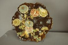 """SATSUMA rare oyster plate with brown ground and large floral motif with gold accent and shell feet, great color and detail, 9"""""""