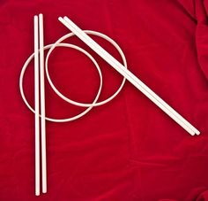 The Graces: This game is played with two small hoops and four sticks.  The hoops are to be bound with silk or ribbons, according to fancy.    Each player takes a pair of sticks and a hoop and then stands a little distance away from the other.  The sticks are held straight, three or four inches apart, when trying to catch the hoop; when the hoop is thrown, the sticks are crossed like a pair of scissors and sharply drawn asunder to drive the hoop toward the other player who endeavors to catch…