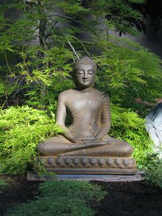 Buddha Statue In Rust In Garden