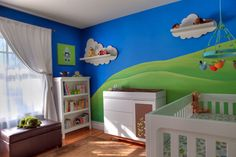 This room is perhaps a little too bold for me, but I still love it. These are the colors I am going to do James' big boy room, with splashes of gray and silver.
