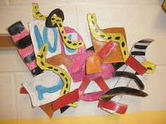 Frank Stella Relief Sculptures  The students were to show an activity in an abstract way. Some chose sports while others picked every day  activities. They used shapes, colors, and patterns that depicted their activity and the way they feel while doing it. We discussed how some types of lines, colors, and patterns give us a feeling of tension and high energy while others are soothing and relaxing. These were all things that the students thought about when creating their sculptures.