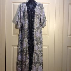 Gorgeous Long Kimono Long kimono wit gorgeous prints and black lace detail. Black, purple, and off white Charlotte Russe Sweaters Cardigans