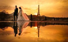 ITAP of a puddle reflecting the Eiffel Tower while a bride and her groom randomly walked by. true story. http://ift.tt/2mqbznf