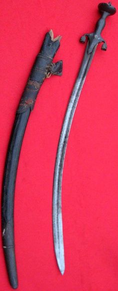 Afghan pulwar sword, with characteristic downturned quillons, 33in long.