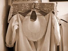 Antique child's dress with linen embroidered bib.