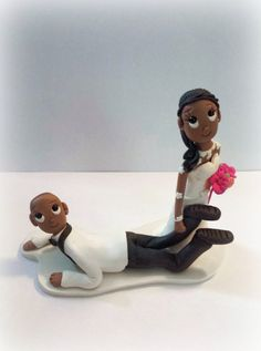 Custom Bride Dragging Groom Wedding Cake by KadoodlesCreation