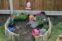 "Let your kids ""help"" in the garden by creating their own sensory play garden!"