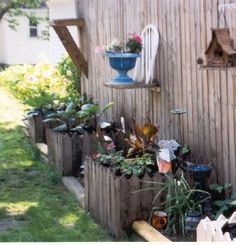 lovemyjunk: Recycled planters and yard art Note: chair made into shelf for urn